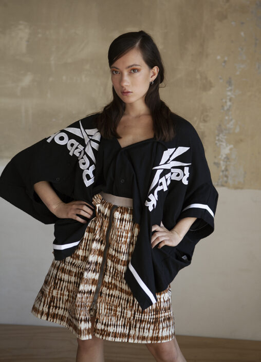 Irene Heldens X Calico Jack RE-DESIGN sustainable fashion collection - Will Falize - Tie dye skirt - Reebok cardigan